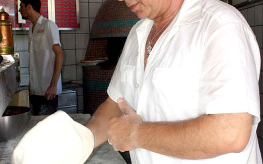 Ciro Palumbo, a pizzaiolo or pizza maker, first kneads and then stretches out dough to make a pizza Wednesday afternoon at the MMP pizzeria, a small locale near the U.S. Navy base at Capodichino in Naples, the birthplace of pizza. Thursday marks the opening day of a 10-day festival in downtown Naples celebrating pizza.