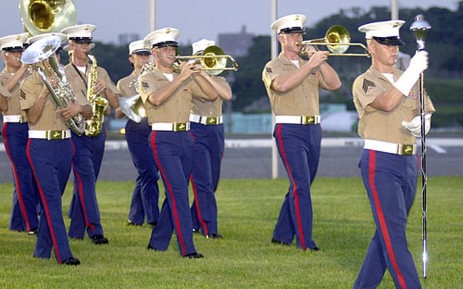 The III Marine Expeditionary Force Band performs at the ceremony.