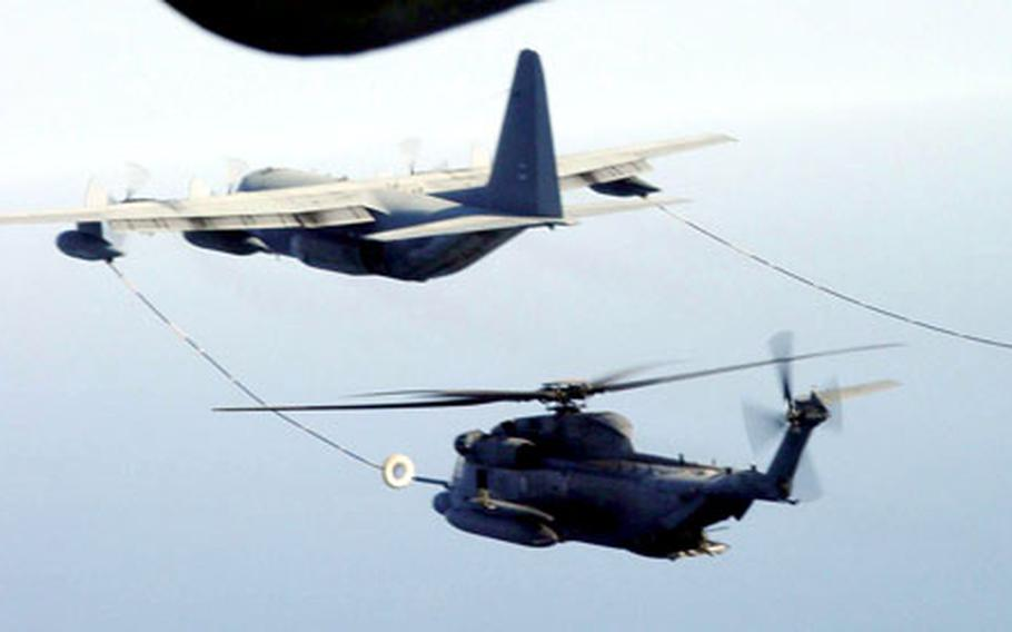 A Joint Task Force Lebanon MC-130P Combat Shadow refuels an MH-53M Pave Low helicopter over the Mediterranean Sea last month. Both aircraft belong to Air Force 352nd Special Operations Group, deployed from RAF Mildenhall, England.