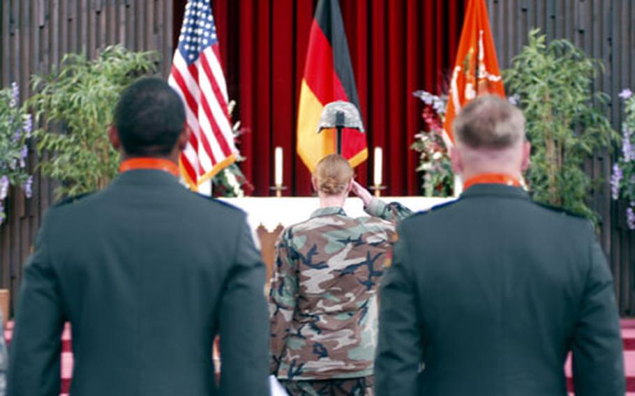 A soldier salutes in memory of fallen comrade Spc. Matthew E. Schneider on Thursday during a memorial service at Hainerberg Chapel in Wiesbaden, Germany. Schneider, a member of Company A, 141st Signal Battalion, died of a heart attack in Ramadi, Iraq, on Aug. 28. He was the first soldier from the battalion to die in Iraq.