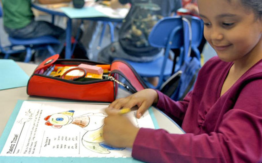 Leia Generally, a second-grader at Robinson Elementary/Middle School in Stuttgart, Germany, colors in her Hispanic Heritage Month coloring book on Friday during class.