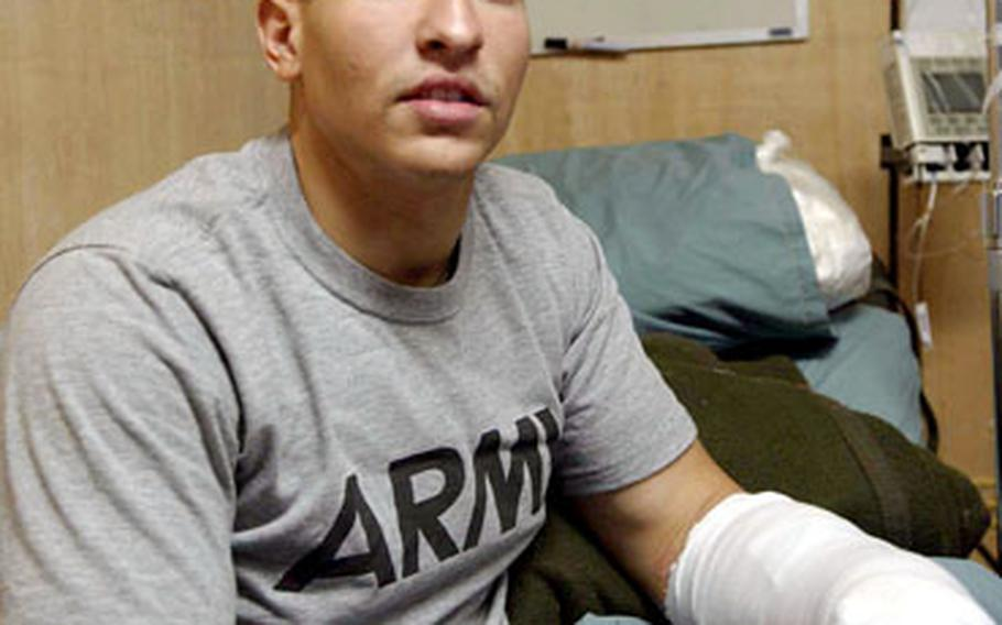 Cpl. Ruben Burgos, wounded during a suicide car bomb attack on a U.S. Army convoy in Kabul, Afghanistan, on Friday, is being treated at the 14th Combat Support Hospital on Bagram Air Base.