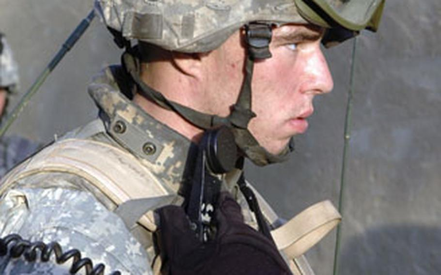 Cpl. Matthew Davis, 21, of Bonney Lake, Wash., relays a radio message to his platoon leader during a reconnaissance patrol of Arab Jabour, a small village south of Baghdad.
