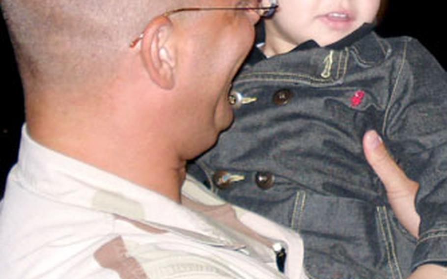 Master Sgt. Donald Villars of the 23rd Fighter Squadron holds his son, Daniel, on Saturday at Spangdahlem Air Base in Germany after returning from a 2½-month deployment to the Persian Gulf region.