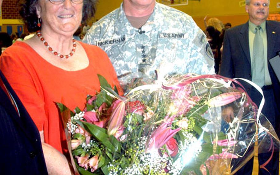 Gen. David D. McKiernan, USAREUR commander, poses with Heidelberg Middle School principal Ellen Minette after a school assembly Monday.
