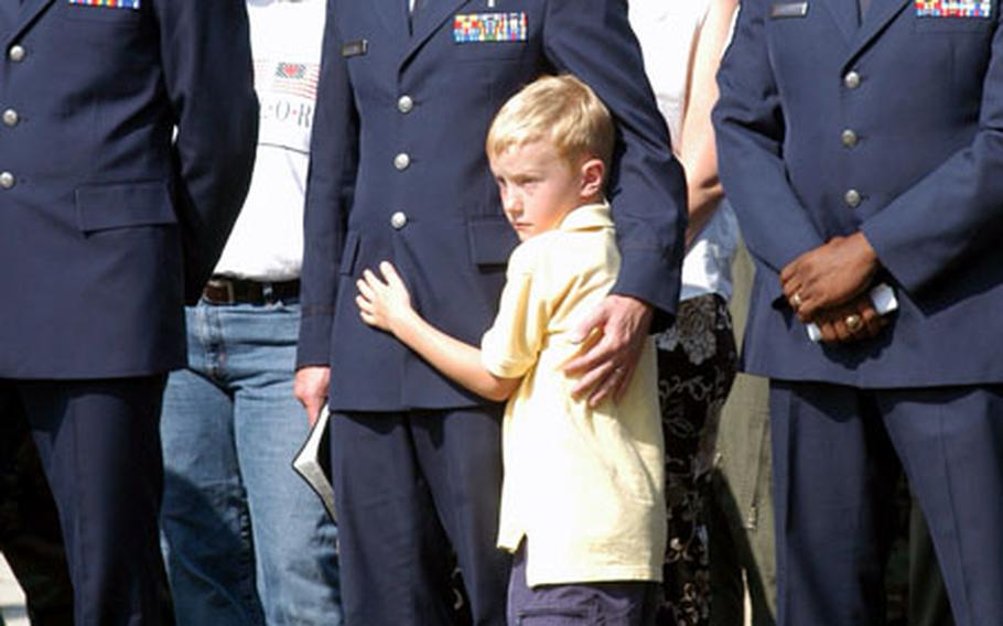 Chaplain (Capt.) Jason Peters of the 100th Air Refueling Wing chapel embraces his 7-year-old son, Wesley, during a 9/11 ceremony at RAF Mildenhall.
