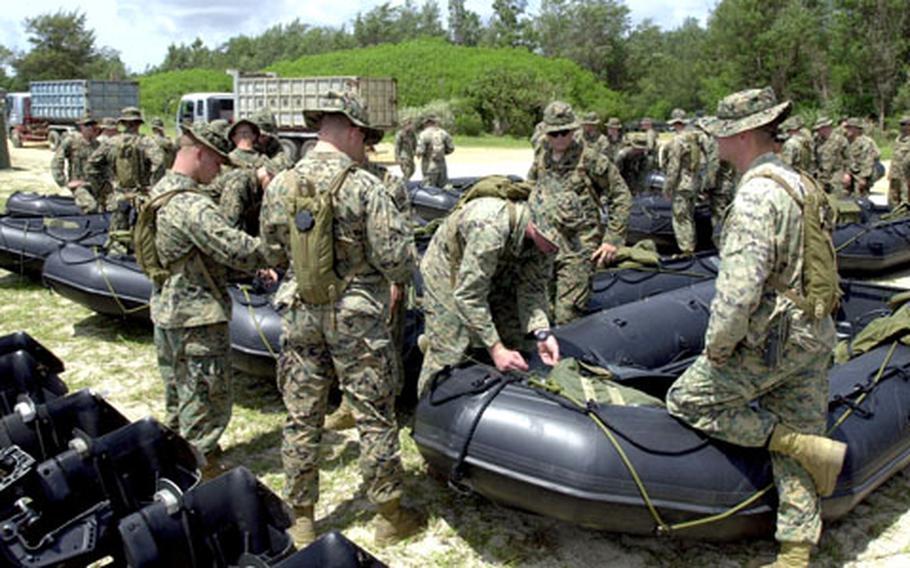 Marines prepare 18 Zodiac boats for boat raid practice runs at Kin Blue Monday.