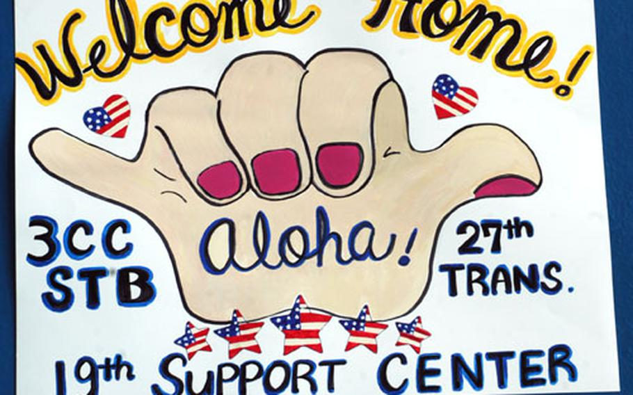 For those soldiers coming home, the walls of the old airfield gym in Wiesbaden were full of dozens of hand-painted signs expressing love and gratitude.