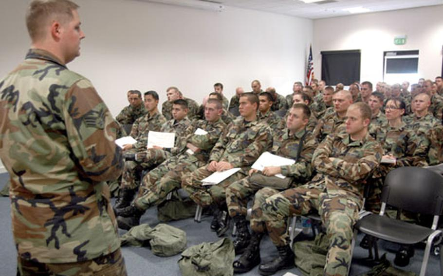 Senior Airman William Lancaster, from the 48th Operations Support Squadron intelligence flight, briefs airmen last Wednesday.