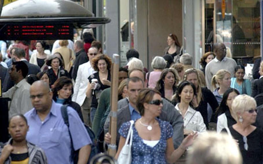 Tourists and Londoners jam Oxford Street each day to shop at Central London's principal clothing district.