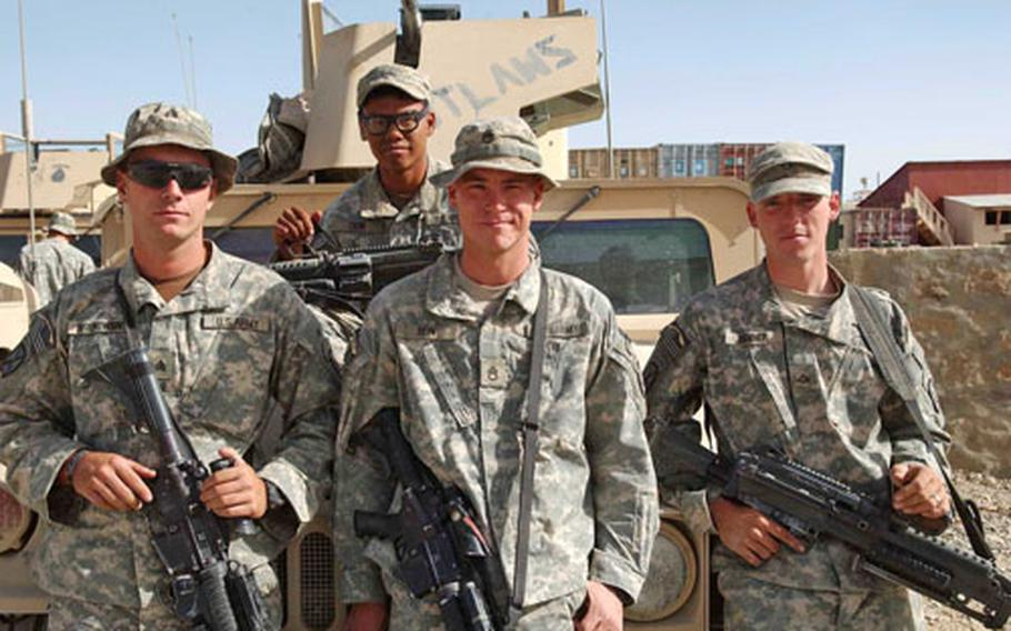 After a convoy from Forward Operating Base Orgun-E, Afghanistan to FOB Sharana, Sgt. Michael Hrehowsik, Pvt. Vandy Thon, Staff Sgt. Robert Rein and Pfc. Brandon Renner stand with their Humvee.