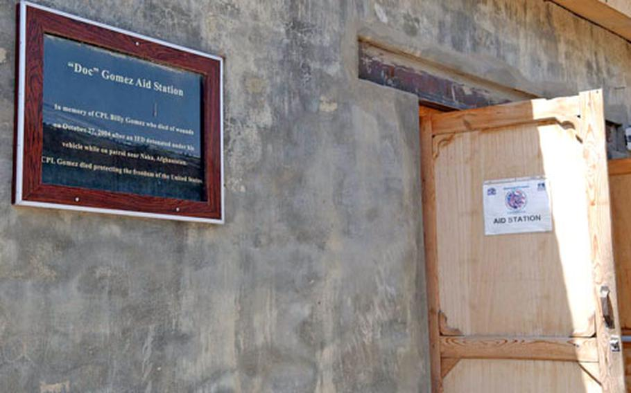 A sign dedicates Forward Operating Base Orgun-E's aid station to Cpl. Billy Gomez, who died Oct. 27, 2004, after a roadside bomb detonated under his vehicle near Naka. A number of spots at the FOB are dedicated to soldiers killed in action in Afghanistan.