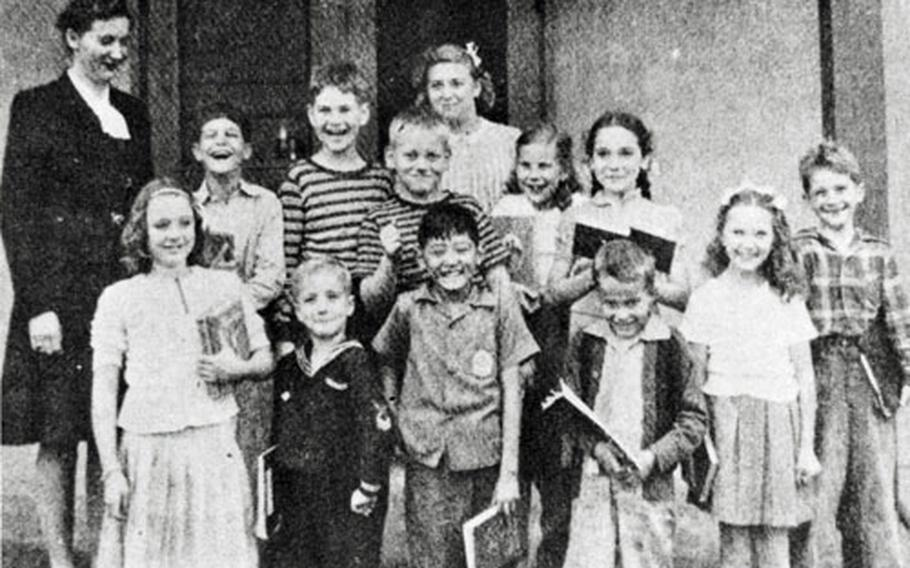A teacher and her students on the first day of school at Yokota Elementary Sept. 12, 1946.