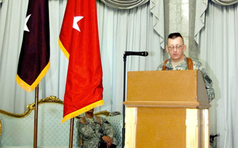 Col. Steven W. Swann, commander of V Corps' 30th Medical Brigade, makes his farewell remarks during a transfer-of-authority ceremony in the Al Faw Palace ballroom at Camp Victory, Iraq, on Thursday.