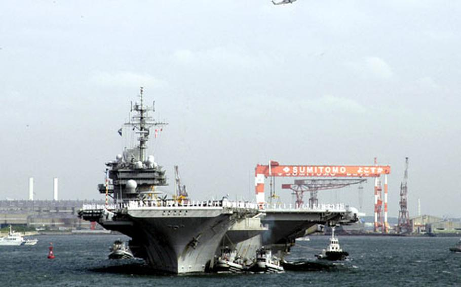 The USS Kitty Hawk returns to Yokosuka Naval Base, Japan, on Friday after a three-month summer at-sea period.
