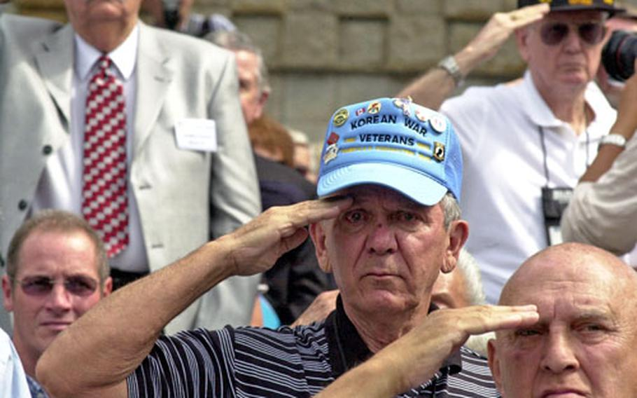 Former Sgt. 1st Class Joseph Barilec, with the 21st Ordnance MM Company during the Korean War, salutes during the national anthem at the 56th commemoration of the Inchon landing in Incheon city, South Korea, on Friday.