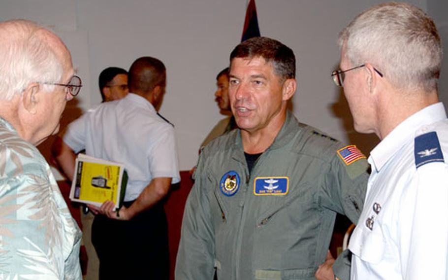 Air Force Lt. Gen. Daniel Leaf, center, talks to John Robertson, left, a Guam Contractors Association board member, and Air Force Col. Wilfred Cassidy, president of the Society of American Military Engineers, on Friday.