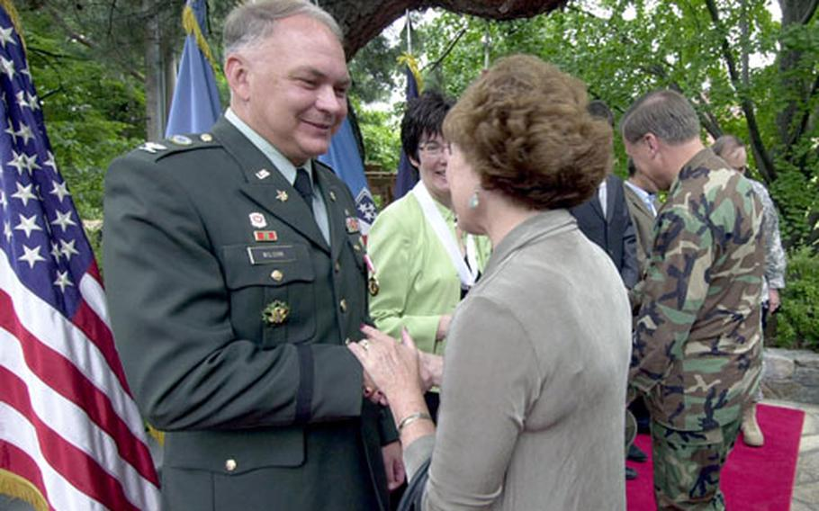 Col. Daniel Wilson, chief U.S. Forces Korea engineer, shakes hands with members of the military community after his retirement ceremony Friday at Yongsan Garrison.