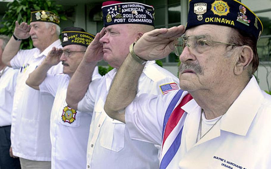 From front to back, Raymond Rossini, Stanley Stewart, Dwayne P. Ash and Dennis E. Provencher, all Vietnam War veterans, salute as the POW/MIA flag is raised with the morning colors Friday at U.S. Naval Hospital Okinawa on Camp Lester.