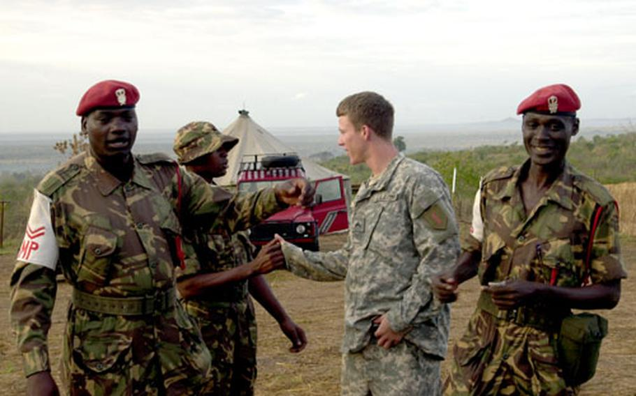 A 1st Infantry Division soldier from Fort Riley, Kan., says goodbye to Tanzanian troops as Exercise Natural Fire wrapped up last month in Tanzania.