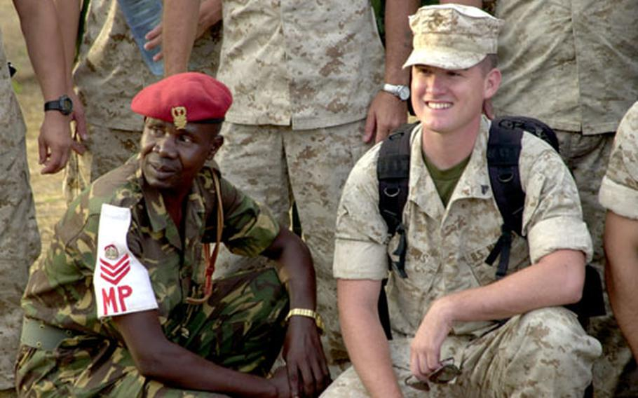 U.S. Marines and Tanzanian soldiers pose for group photos as the Marine construction battalion prepares to end Exercise Natural Fire and fly home to the States.