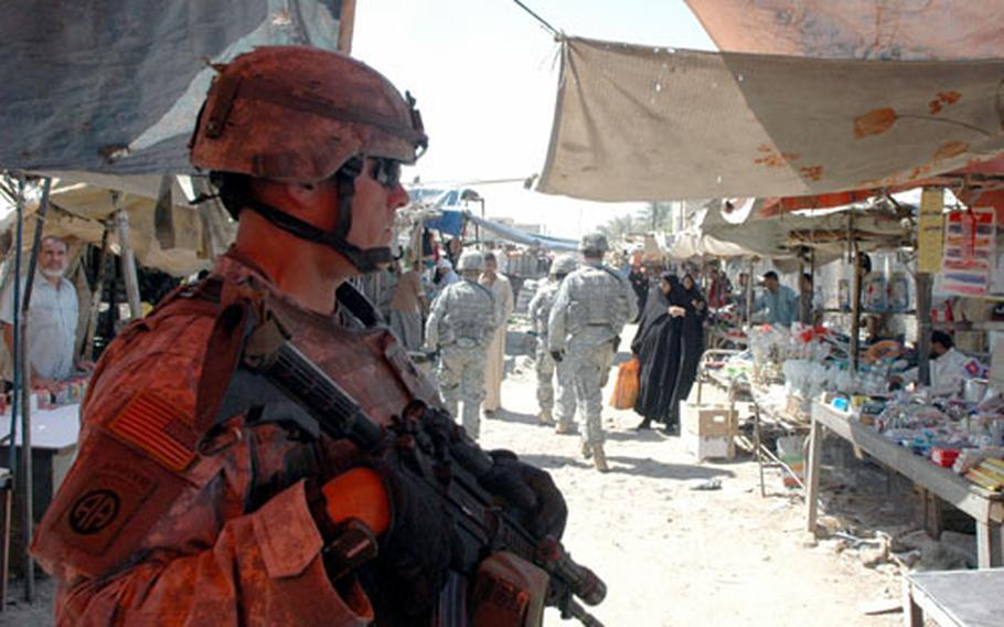 Lt. Col. Al Kelly surveys a market in a poor Shiite section of northern Baghdad during clearing operations on Friday. Kelly and his battalion now have permission to usenonlethal weapons against unruly residents in Sadr City.