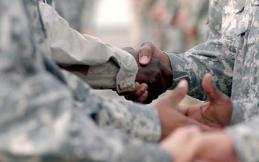Leaders from U.S. Army Europe, the 3rd Corps Support Command and the 596th Maintenance Company shook hands with hundreds of 596th soldiers before a farewell ceremony Friday.