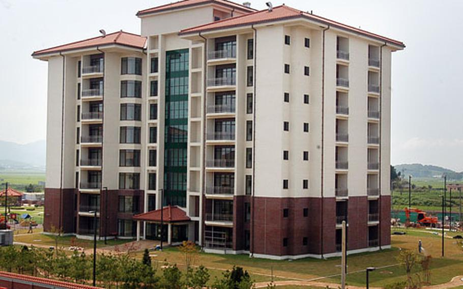 Camp Humphreys officials will open this new eight-story family apartment tower and underground parking garage this week.