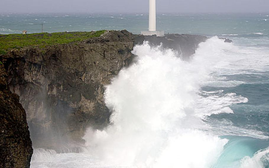 The trailing edge of Typhoon Shanshan causes spectacular waves to crash into the cliffs of Zanpa Point, Okinawa, at 7:30 a.m., about an hour after high tide on Sunday.