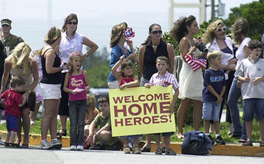 Family, friends and fellow Marines gather Sunday to await the return from Iraq of about 280 Marines with 9th Engineer Support Battalion.