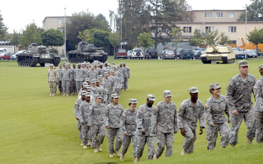 A half-day removed from Kuwait, members of the 3rd Corps Support Command file into the old gymnasium on Wiesbaden Army Airfield in Germany for a brief welcome home ceremony on Monday.