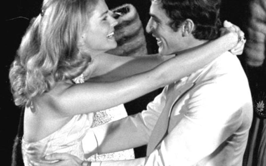 """Candice Bergen and Bekim Fehmiu dance during the filming of a scene from """"The Adventurers."""""""