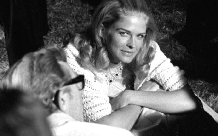 Bergen talks with director Lewis Gilbert.