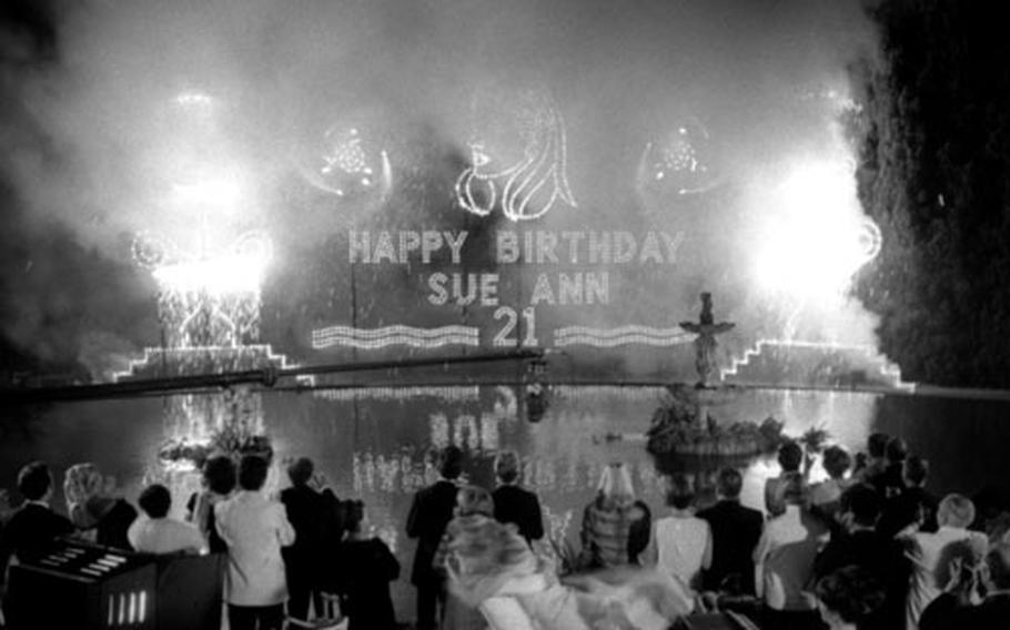 Birthday greetings for Sue Ann Daley (played by Bergen) are presented in fireworks.
