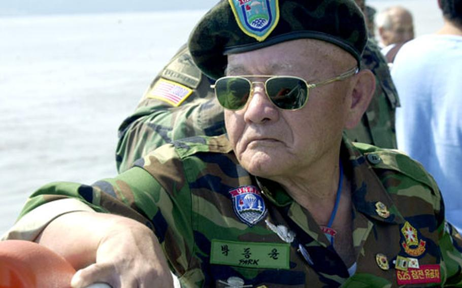 A member of the Federation of Partisan Forces Korea enjoys the sun while on a ferry ride to Kyodong Island on Tuesday.