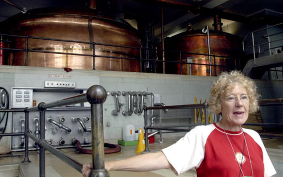 Tour guide Doreen Taylor does not brew the beer she talks about each day, but she pours pints by the dozen at the end of the tour.