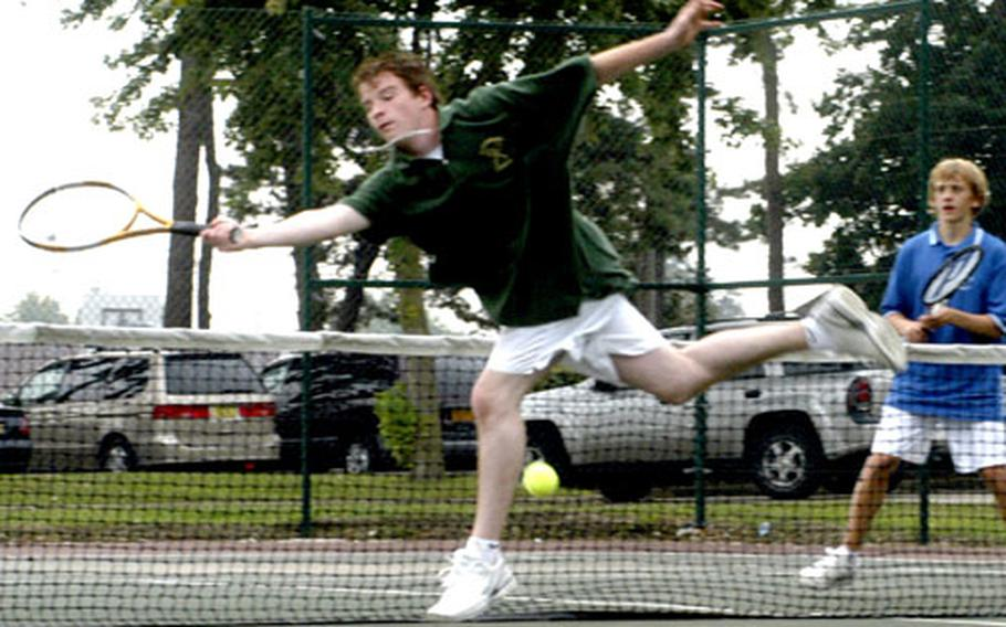 Alconbury tennis player Lyndon Bacon reaches out for a missed volley during the No. 1 doubles play between London Central High School and Alconbury High School.