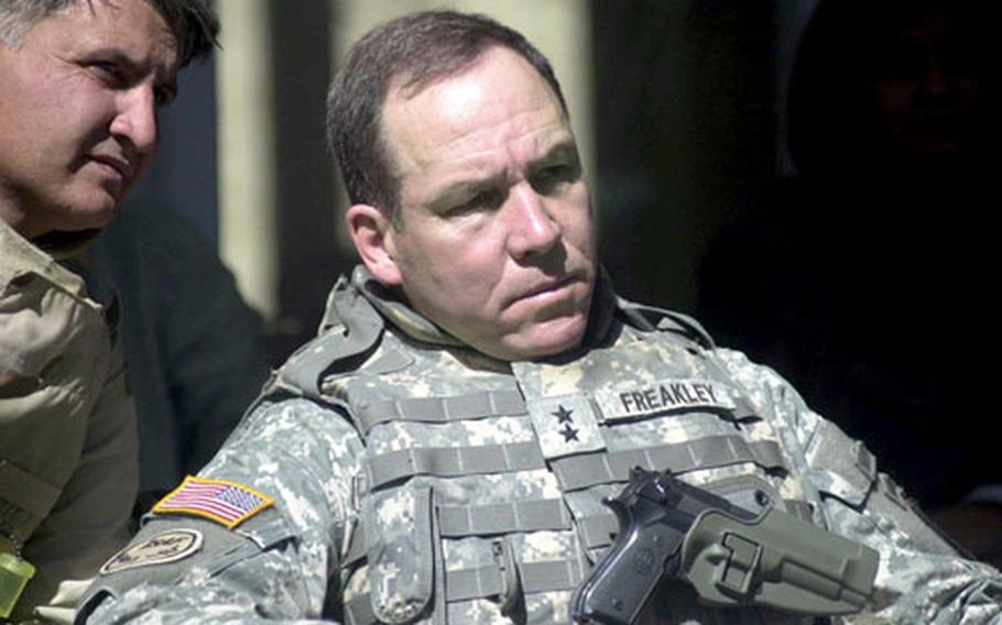 Maj. Gen. Benjamin C. Freakley listens through an interpreter to what is being said at the shura.
