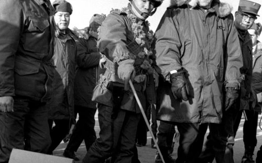 South Korean Lt. Col. Duk Soo Kim fills the vice president in on troop conditions on the peninsula.