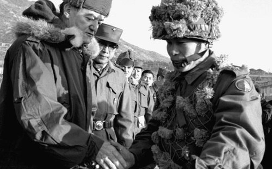 Vice President Humphrey talks with Lt. Col. Duk Soo Kim.