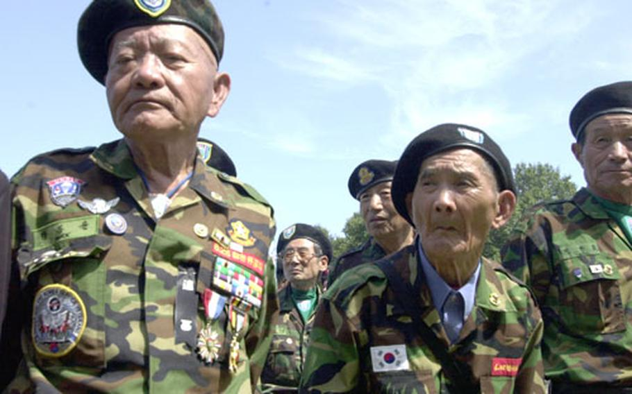 Members of the Federation of Partisan Forces Korea stand in formation on Kyodong Island during a ceremony on Tuesday.
