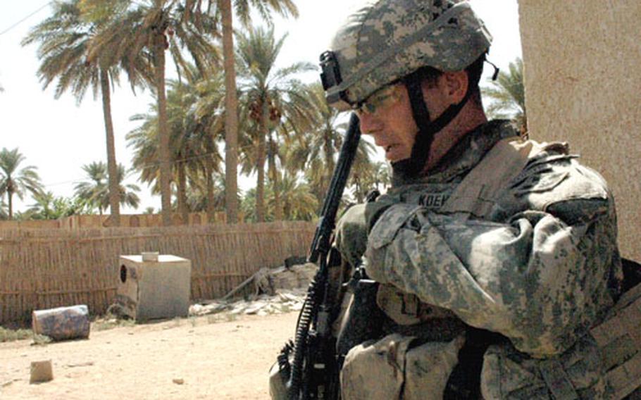 U.S. Army Capt. Matt Koehler, 34, of Kansas City, Mo., relays the progress of a recent raid in Jurf As Sakhir.