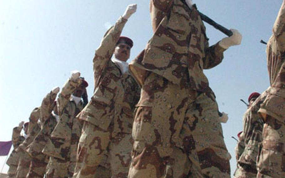 Soldiers with the 2nd Battalion, 4th Brigade, 8th Iraqi Army Division march past a reviewing stand.