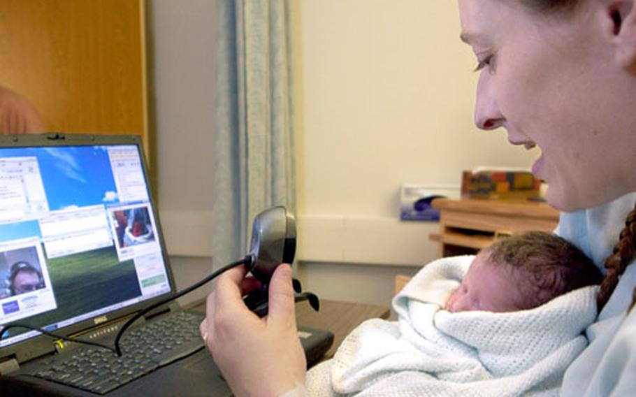 Kirsten Smith uses a webcam to introduce Sabine Elisabeth to the baby's father, Spc. Kevin Anderson, after giving birth at Landstuhl Regional Medical Center on Thursday.