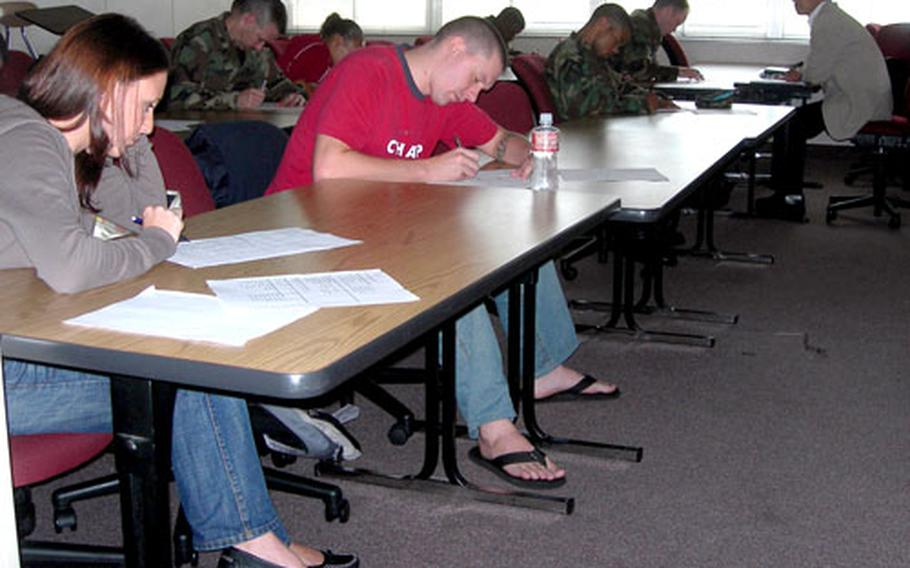 Servicemembers and civilians take a test in Moriaki Kanai's Elementary Japanese class at the University of Maryland College at Yokota Air Base, Japan, September of 2006.