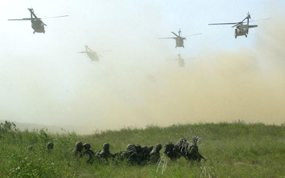 The first wave of the 2nd Infantry Division's Combat Aviation Brigade Blackhawk helicopters airlifts U.S., United Nations and South Korean servicemembers during a mock evacuation of the Joint Security Agency at Story Range.