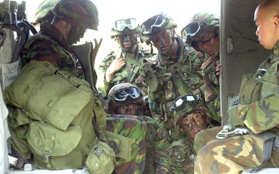 South Korean soldiers learn about boarding a U.S. Army Blackhawk helicopter during a briefing at Camp Story.