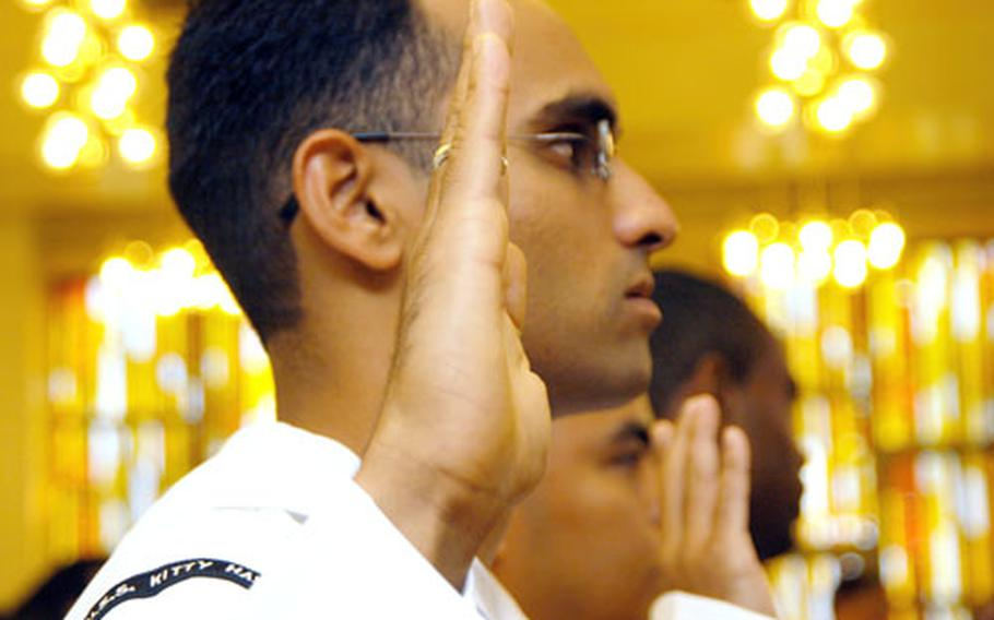 Petty Officer 2nd Class Syed Yawar Abbas, from the USS Kitty Hawk, took the oath of allegiance at a U.S. naturalization ceremony at Yokosuka Naval Base on Friday. Abbas is from Pakistan.