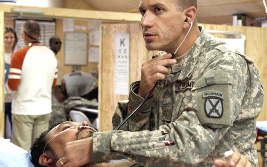 Dr. (Maj.) Chris Lettieri checks Martin Foley, who had been rushed to the 14th Combat Support Hospital on Bagram Air Base, Afghanistan, after complaining of chest pains.