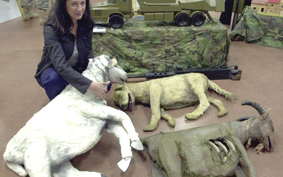 Jasna Vojnovic, a visual information specialist with the General Support Center Rodelheim, shows off models of dead animals that will be used in Germany for training against hidden roadside bombs in Iraq and Afghanistan.